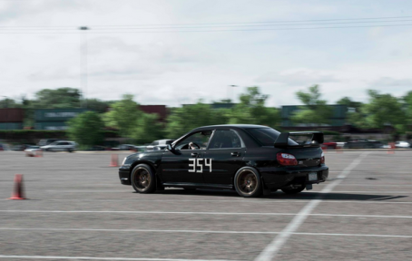Ben's racing Subaru crossing the finish line at an Autocross race.